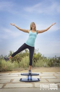 Woman standing on a StrongBoard Balance Board