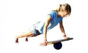 Woman doing a plank on a balance board
