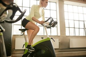 Woman on an exercise bike