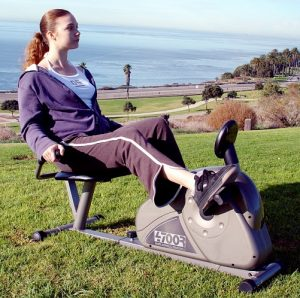 Young woman using a recumbent exercise bike